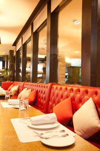 leather-chairs-near-mirror-in-steak-restaurant
